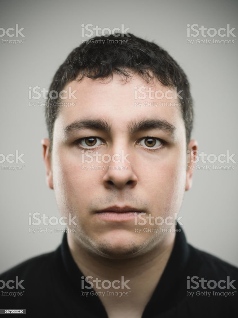 Portrait of a real young caucasian man stock photo