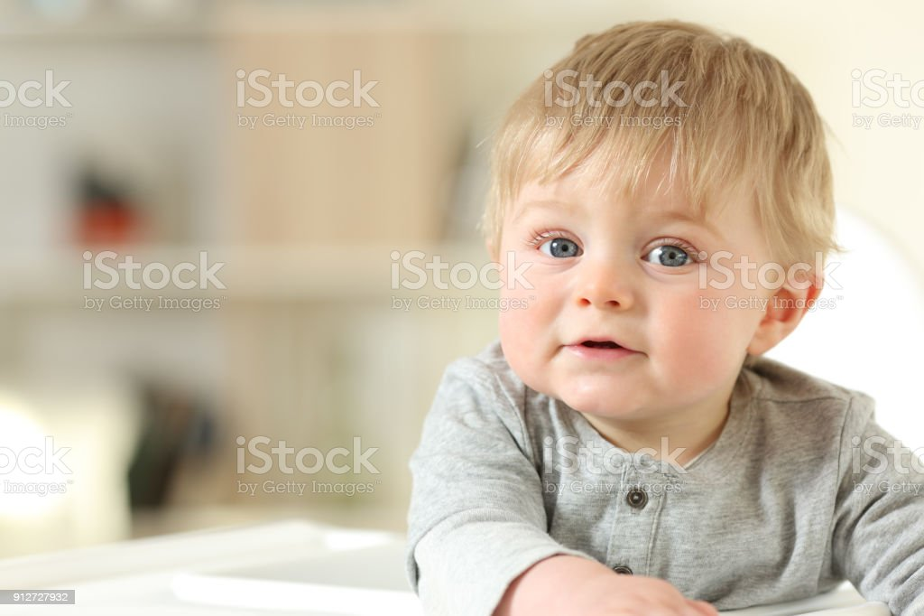 Portrait of a relaxed baby looking at you stock photo