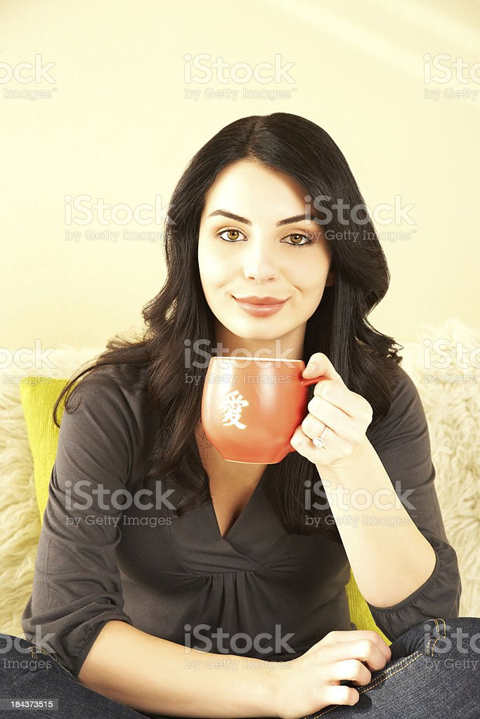 Portrait of a relaxed casual young woman having morning coffee royalty-free stock photo