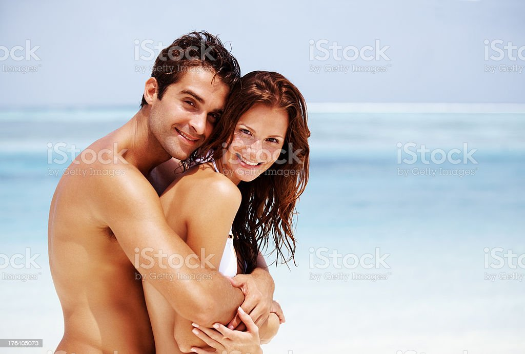 Portrait of a romantic young couple at the beach stock photo