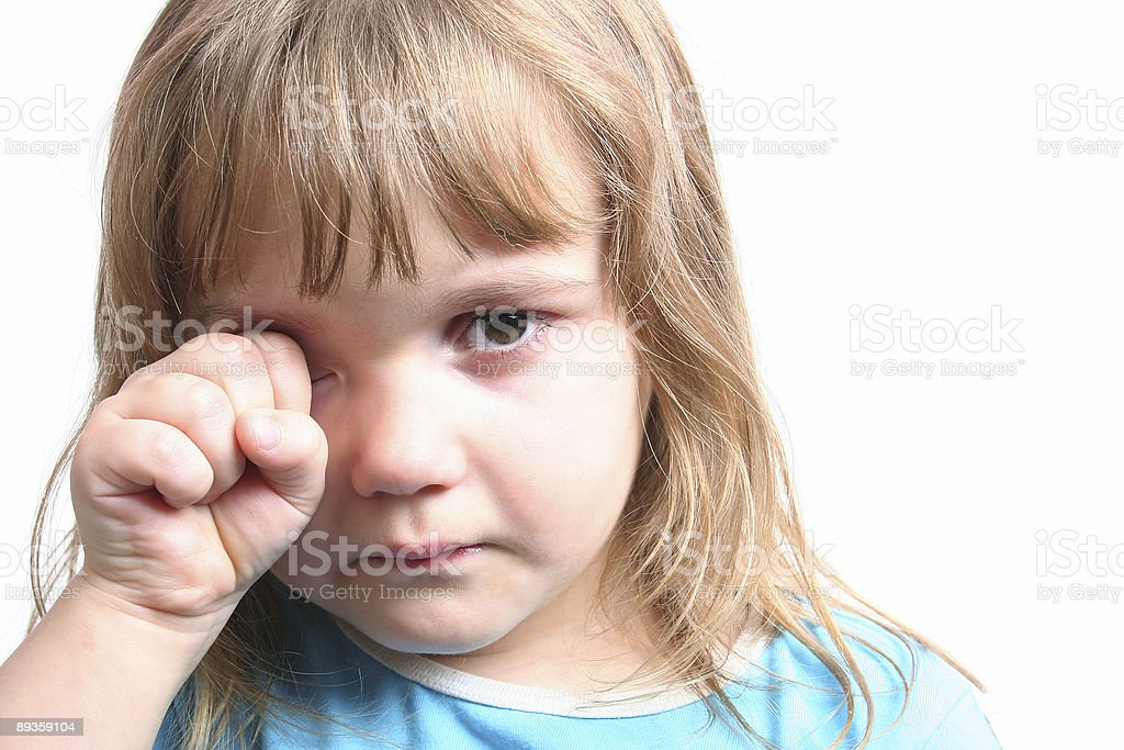 Portrait of a sad girl wiping tears from here eyes royalty free stockfoto