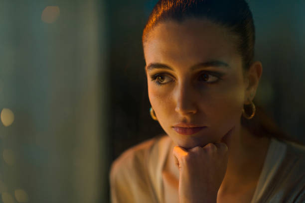 Portrait of a sad lonely woman looking away stock photo