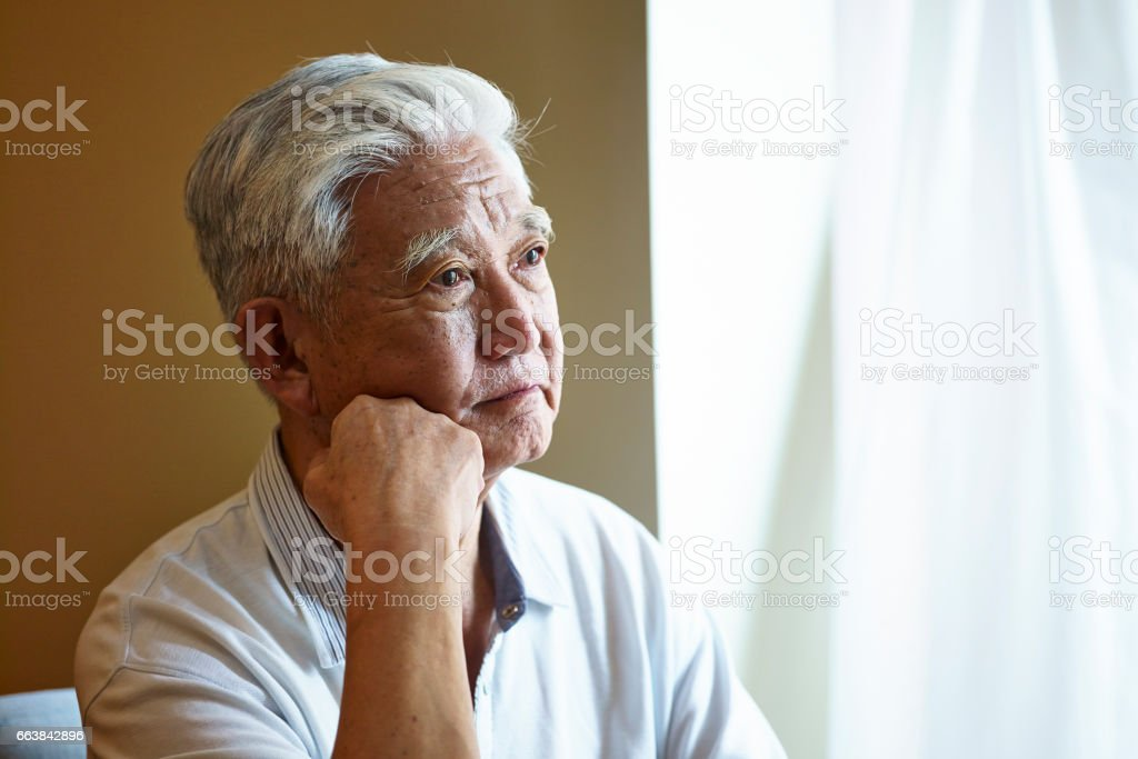 portrait of a sad senior asian man stock photo