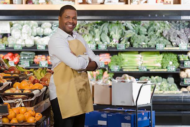 Portrait of a sales assistant Portrait of a sales assistant grocer stock pictures, royalty-free photos & images
