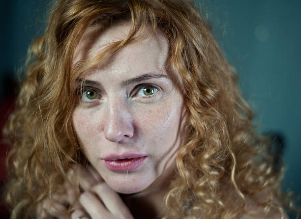portrait of a scary women - woman green eyes red hair stock photos and pictures