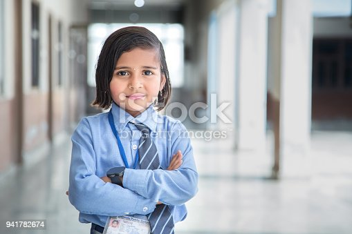 941782244 istock photo Portrait of a school girl smiling 941782674