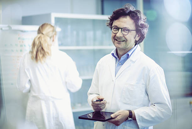 portrait of a scientist in a modern laboratory - laboratory coat stock photos and pictures