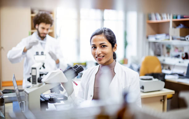 Portrait of a scientist in the laboratory Portrait of a scientist in the laboratory microbiologist stock pictures, royalty-free photos & images