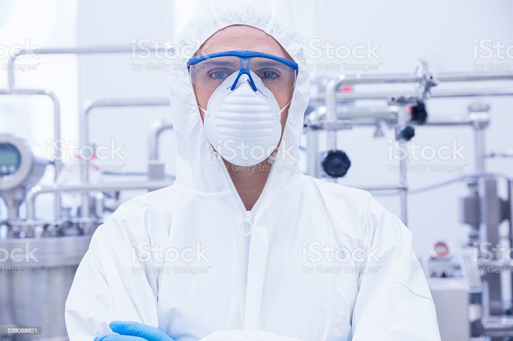 Portrait of a scientist standing with arms crossed stock photo