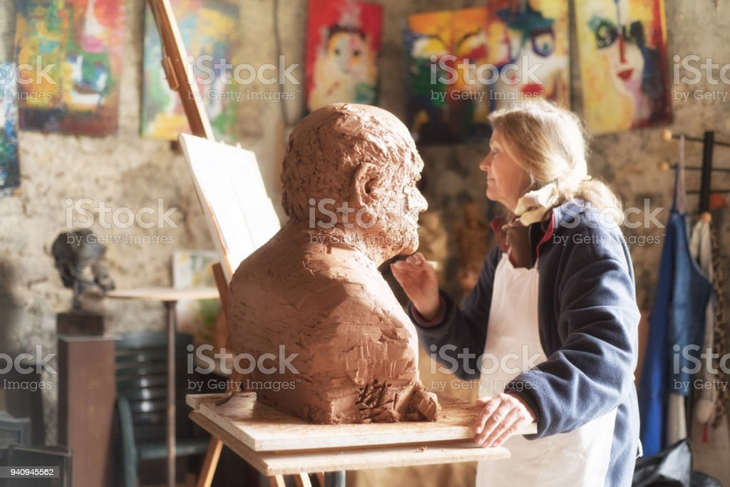 Portrait of a sculptor in her workshop, Provence stock photo