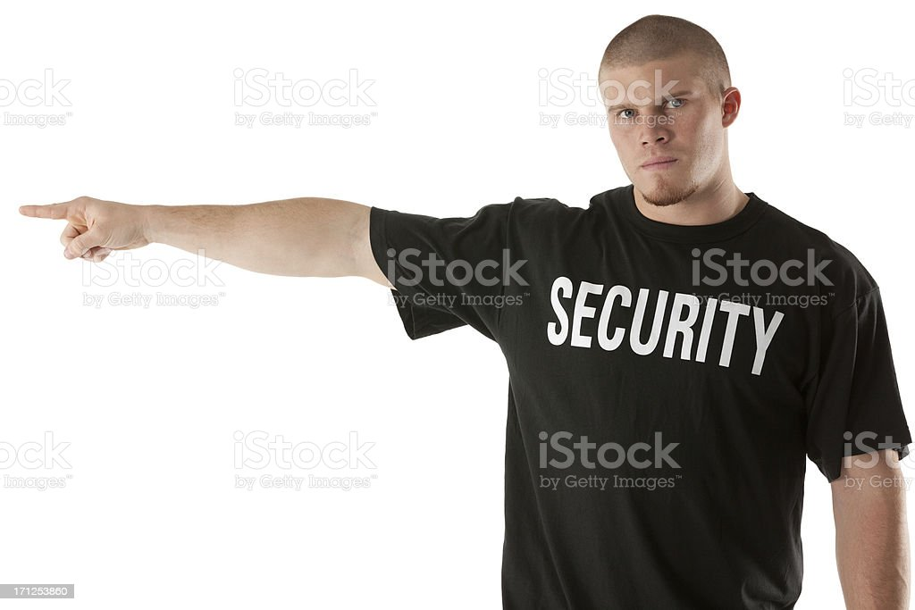 Portrait of a security guard pointing stock photo