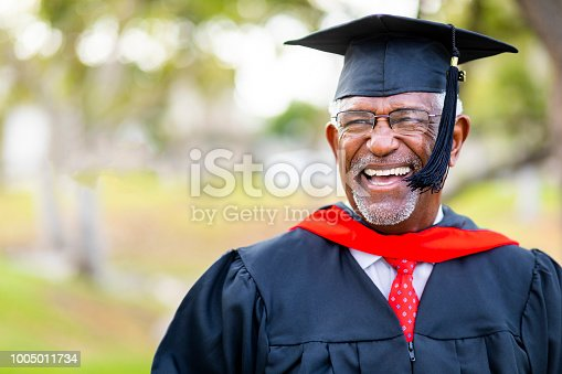 A senior black man graduates with his master's degree