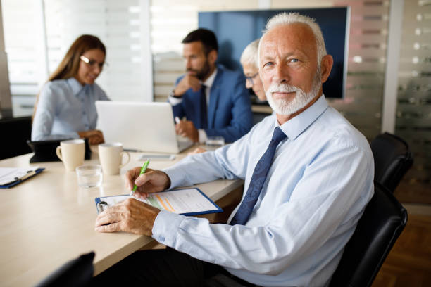 Portrait of a senior businessman at work stock photo