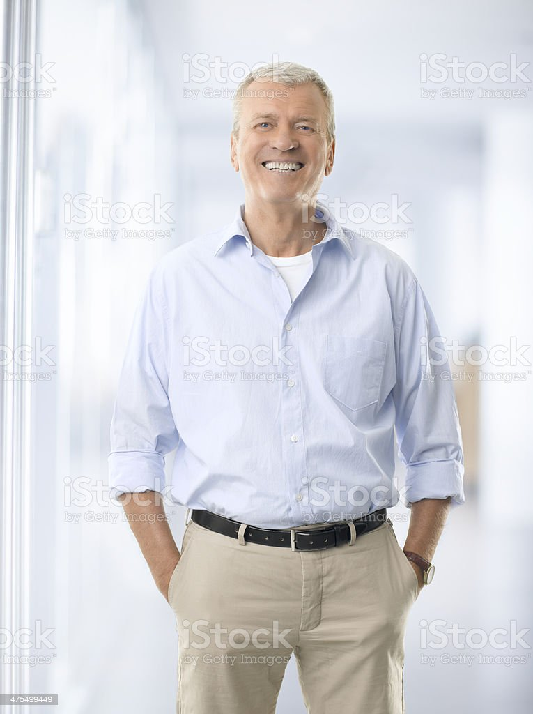 Portrait of a senior businessman smiling stock photo