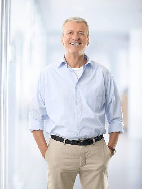 Portrait of a senior businessman smiling stock photo