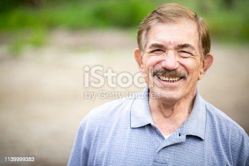 Portrait of a senior caucasian man in nature