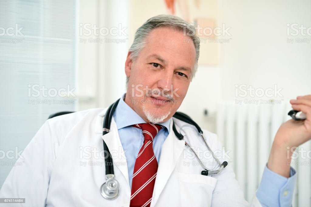 Portrait of a senior doctor in his studio royalty-free stock photo