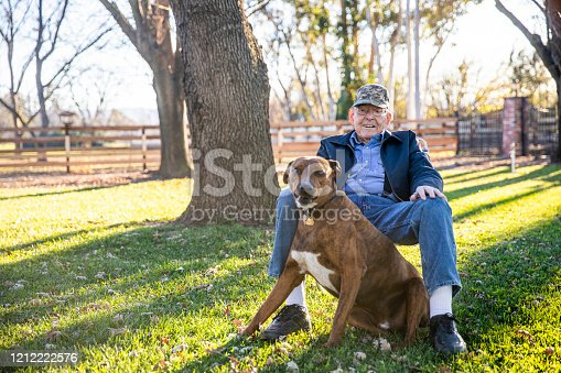 A senior farmer with his dog