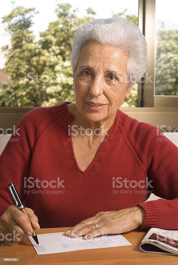 Portrait of a senior lady writing royalty-free stock photo