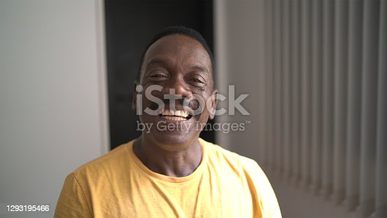 istock Portrait of a senior man at home 1293195466
