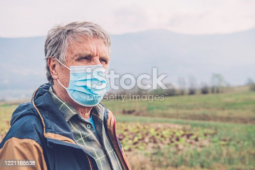 Portrait of a senior man in the radicchio field in Slovenia, Europe. Nikon D850.