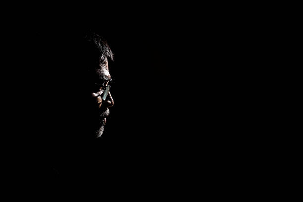 Portrait of a senior man in dark background. stock photo