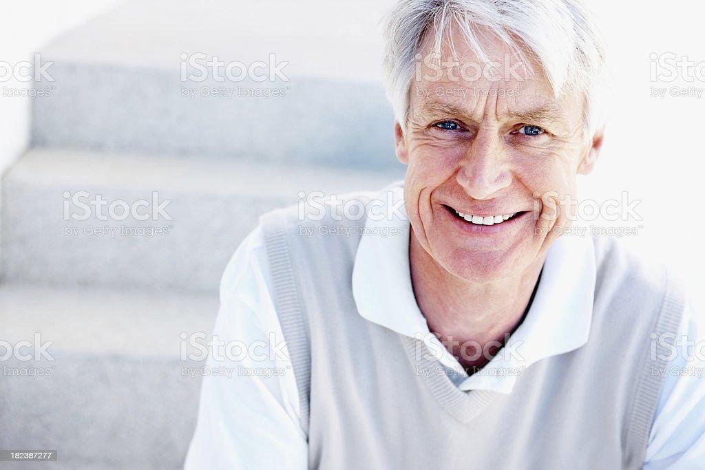 Portrait of a senior man smiling royalty-free stock photo