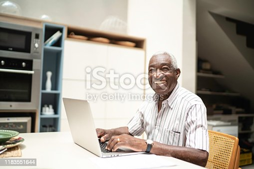 1127582480istockphoto Portrait of a senior man using laptop at home 1183551644