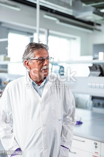istock Portrait of a senior man working in a laboratory and wearing a labcoat 1145252892