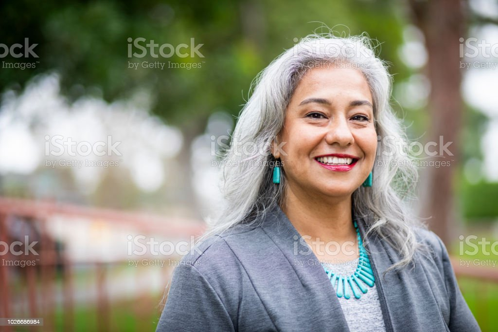 Portrait of a Senior Mexican Female Administrator stock photo