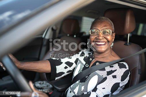 Portrait of a senior woman driving a car
