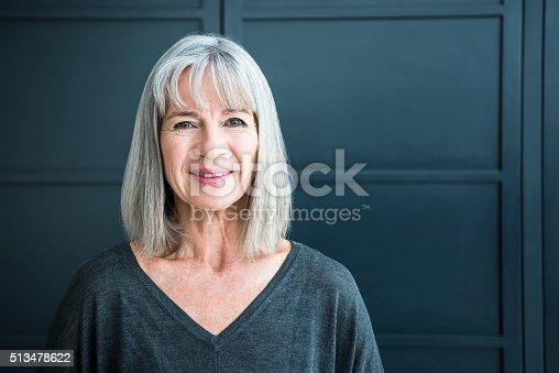 istock Portrait of a senior woman smiling towards camera 513478622