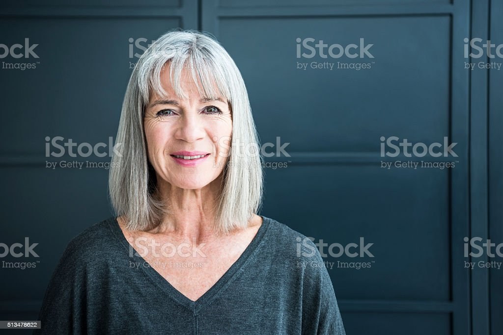 Portrait of a senior woman smiling towards camera stock photo