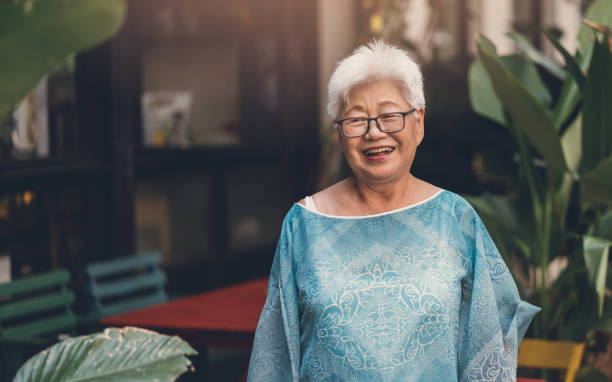 Portrait of a senior woman with grey hair stock photo