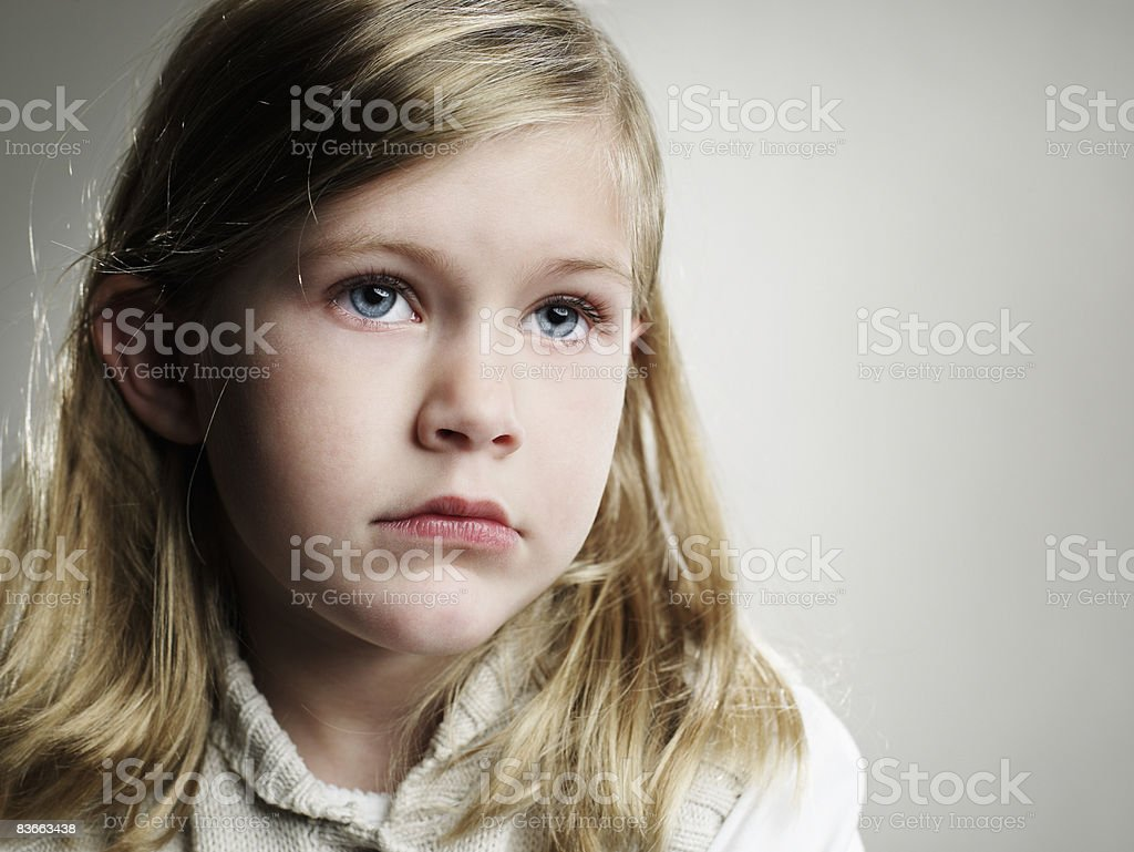 Portrait of a serious 5 year old girl. royalty-free stock photo