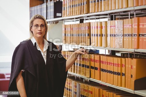 1070981872istockphoto Portrait of a serious lawyer with reading glasses 538203003