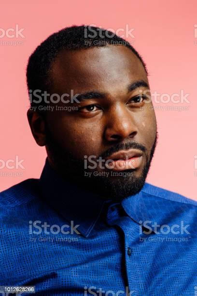 Portrait of a serious man in blue shirt looking off camera picture id1012628266?b=1&k=6&m=1012628266&s=612x612&h=opgnxmvsnfkbbvywuewrynazwxel jtnhssjwtaecwq=