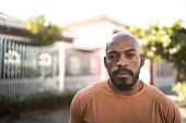 istock Portrait of a serious mature man in the street 1235244763