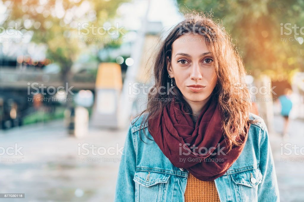 Portrait of a serious woman on the street stock photo