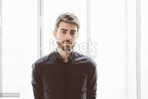 istock Portrait of a serious young man 544979402