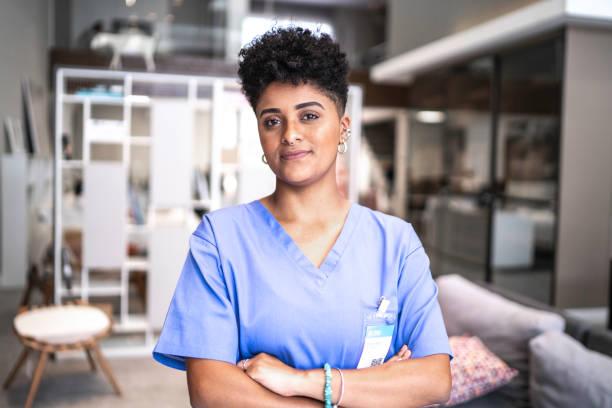 portrait of a serious young nurse/doctor - infermiera personale medico foto e immagini stock