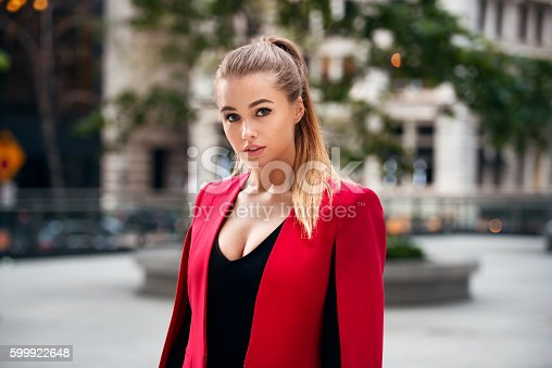 1162297213 istock photo Portrait of a sexy beautiful businesswoman walking in a city 599922648