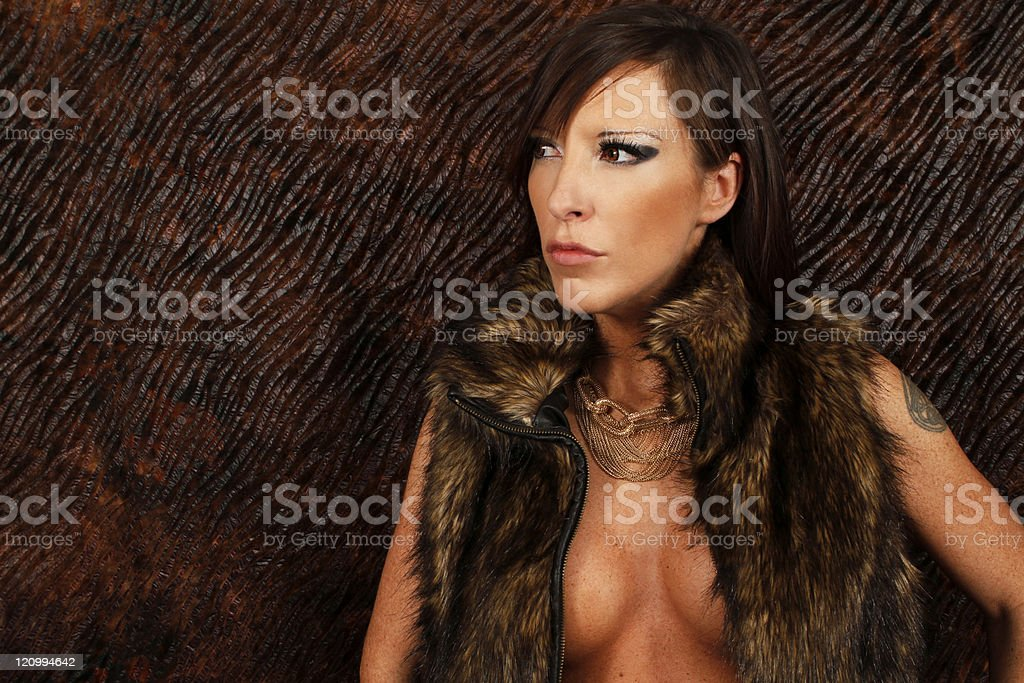 Portrait of a sexy lady with fur jacket stock photo