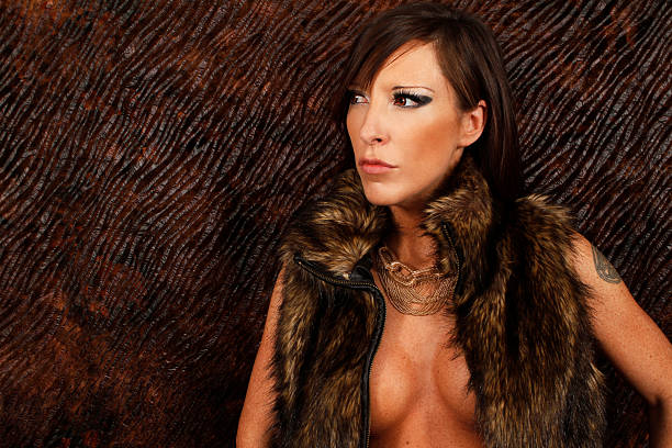 portrait of a sexy lady with fur jacket - naked women with animals stock photos and pictures