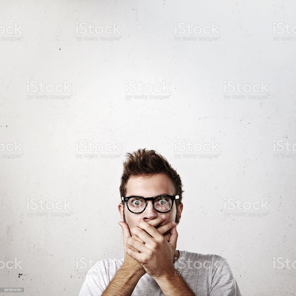 Portrait of a shocked young man stock photo