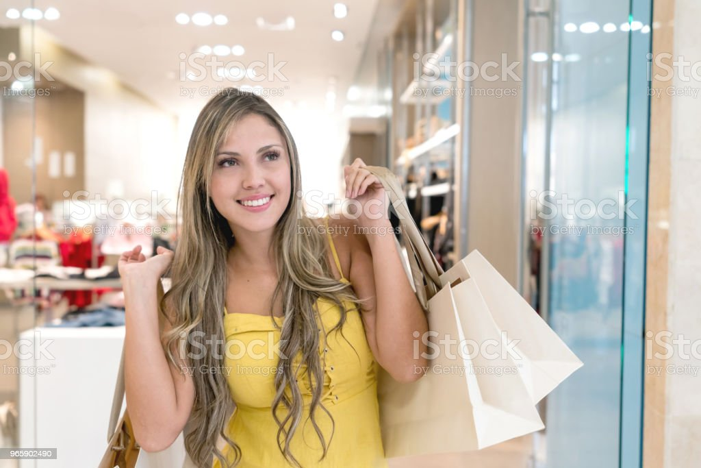 Portrait of a shopping woman holding bags - Royalty-free 20-29 Years Stock Photo