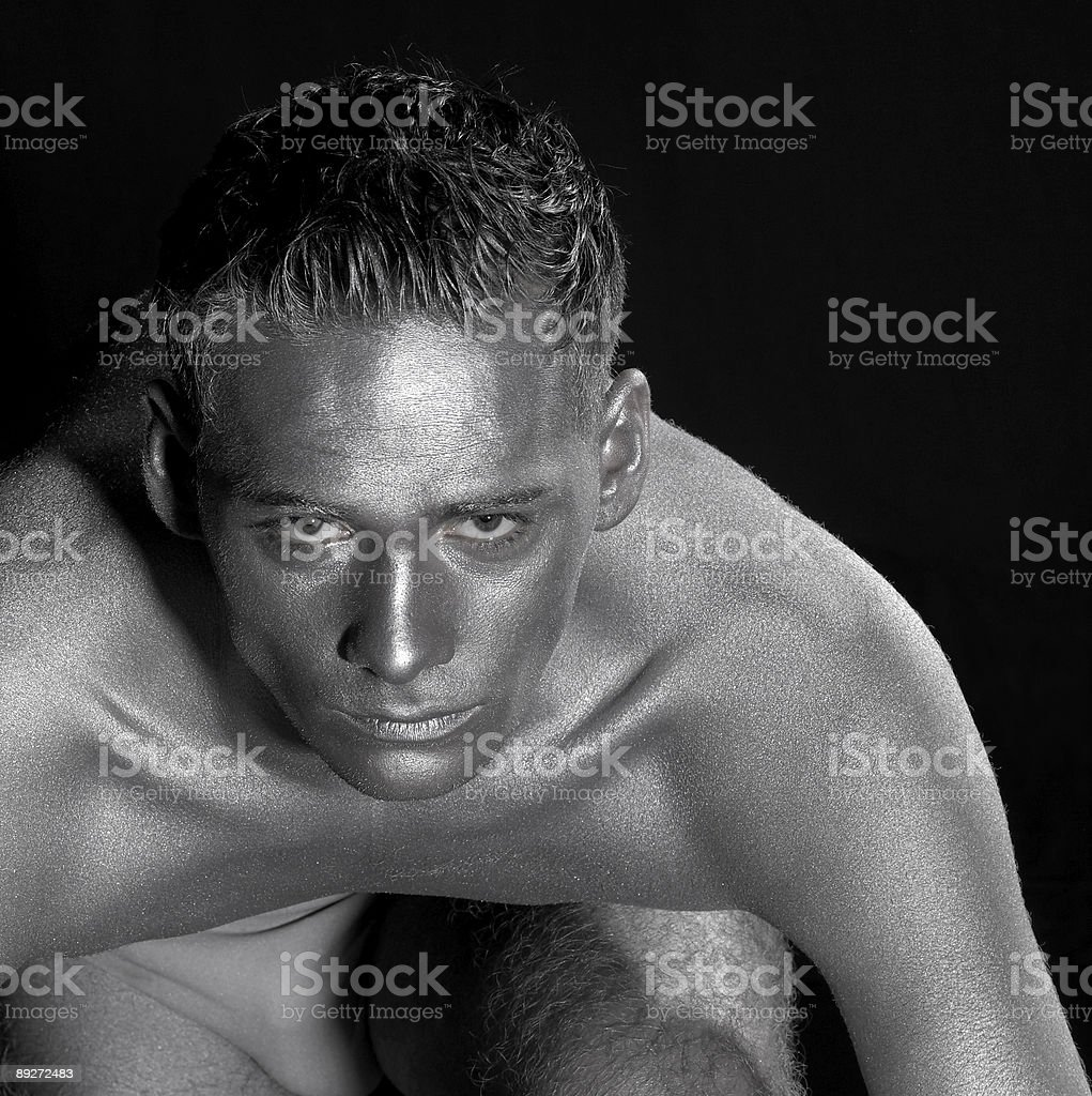 portrait of a silver bodypainted man stock photo