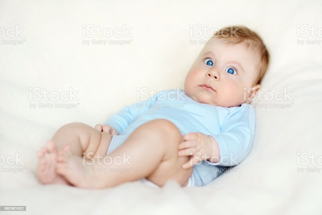 Portrait of a sitting little baby boy foto de stock libre de derechos