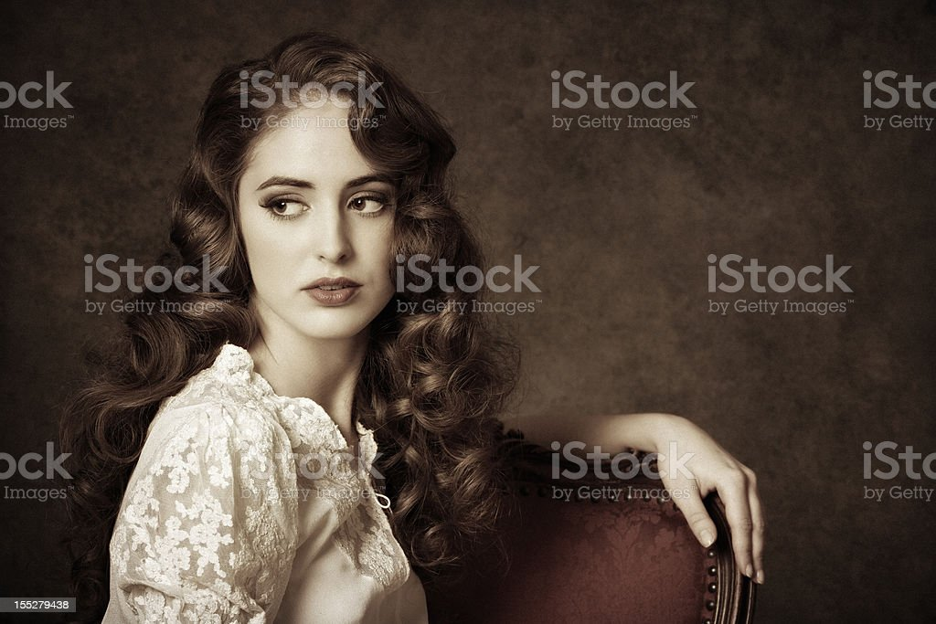 portrait of a sitting woman stock photo