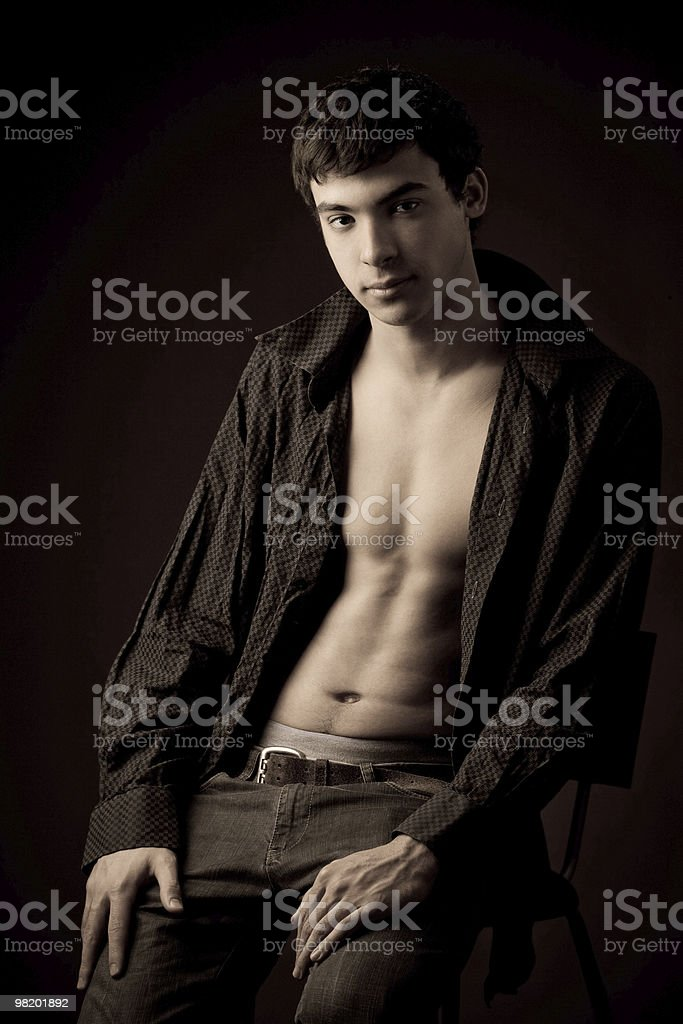 portrait of a sitting young man royalty-free stock photo